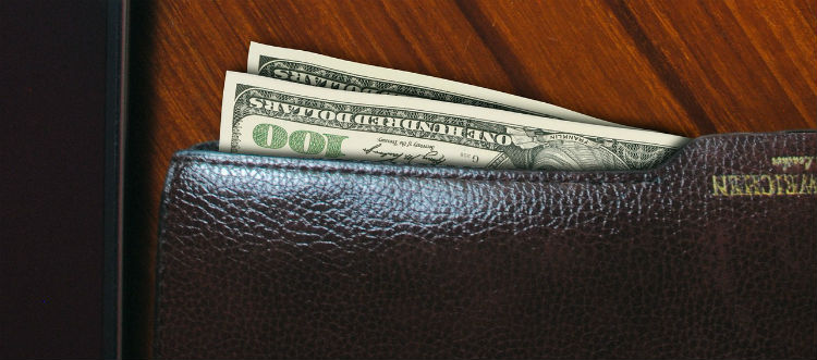 Money Poking Out Of Wallet